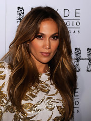 Jennifer Lopez celebrated the release of her newest single 'Goin' In' wearing her luxe tresses in softly waved layers.