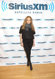Jennifer donned skin-tight leggings with lace-up boots for her visit to the Sirius Radio studios.