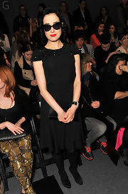 Dita Von Teese topped off her beaded LBD with classic black satin pumps.