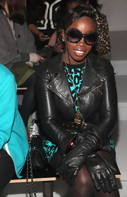 Estelle topped off her printed dress with a cool leather jacket.