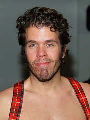 Perez Hilton complemented his, um, suspenders with a cute curly 'do at the Jeremy Scott fashion show.