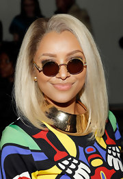 Kat Graham not only showed her quirky style through her brightly colored dress but also through her retro-inspired round sunglasses.