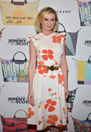 Kirsten Dunst wore a fun and flirty sleeveless dress that was floral-inspired with ruffled shoulders at the Jeremy Scott for Longchamp 10th Anniversary