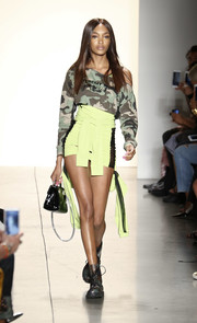 Jourdan Dunn walked the Jeremy Scott runway wearing a camo-print boatneck sweater.