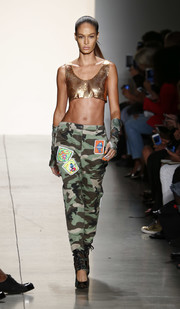 A pair of camo-print lace-up pumps finished off Joan Smalls' look.