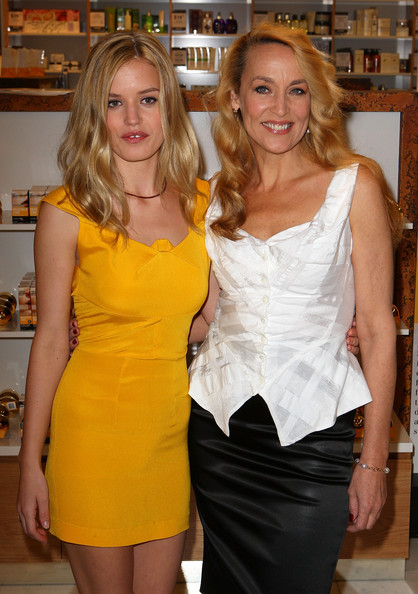 Jerry wears a white fitted blouse with a black pencil skirt while posing with her daughter, Georgia.