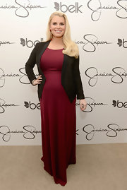 Jessica Simpson dressed up her long maxi with a classic black faux suede jacket.