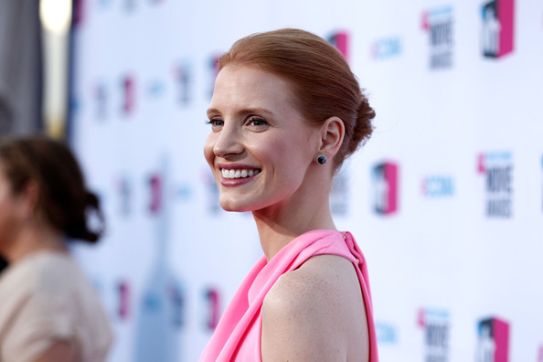Jessica Chastain Classic Bun [red carpet,hair,face,hairstyle,skin,beauty,eyebrow,chin,lip,fashion,pink,jessica chastain,critics choice movie awards,california,los angeles,the hollywood palladium]