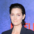 Carrie-Anne Moss' Gelled-Back Hair