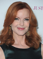 'Desperate Housewives' star Marcia Cross attended the launch of 'JustFabulous' wearing Rust Burst earrings.