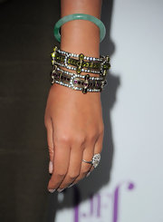 Kimmora Lee Simmons added a sparkling touch to her look with matching bronzed bracelets. Green and purple gemstones accented her baubles.