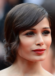 A dark crimson red lip complemented Freida's sultry and sexy beauty look at the 'Jeune et Jolie' premiere in Cannes.