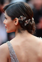 Freida's jeweled bee brooches add a touch of sparkle and whimsy to the star's lovely look.