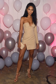 Chanel Iman paired her sexy frock with nude ankle-strap heels by Jimmy Choo.