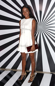 Genevieve Jones wore classic gold and black strappy sandals to the Jimmy Choo and Rob Pruitt Collection Launch.
