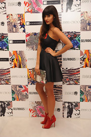 Snapped at a launch party for Jimmy Choo, Jameela Jamil showcased a pair of red statement heels by the label.