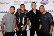 Oritse Williams' hooded puffer vest was a cool finish to his outfit at the Jingle Bell Ball.