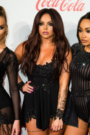 Jesy Nelson flaunted her voluptuous figure in a low-cut black skater dress at the Jingle Bell Ball.