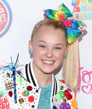 JoJo Siwa completed her twee accessories with a pair of blue bow earrings.