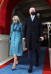 Jill Biden coordinated her look with a pair of teal pumps by Jimmy Choo.