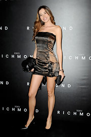 Aida Yespica sizzled in a tiny brown strapless dress at the John Richmond fashion show.