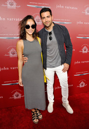 Cara Santana donned a black-and-white striped tank dress (which coordinated perfectly with boyfriend Jesse Metcalfe's outfit, for the Stuart House Benefit.