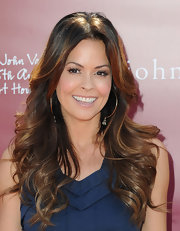 Brooke Burke attended the 8th Annual Stuart Benefit showing off bouncy center part curls.