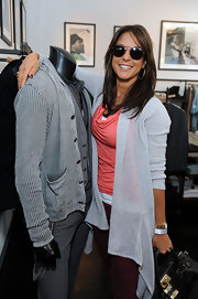 Eva la Rue piled on the pastels at the Stuart House benefit, layering a blue high-low cardigan over a coral cowl-neck top.