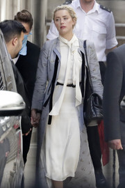 Amber Heard looked angelic in a white tie-neck midi dress by Valentino during Johnny Depp's libel trial.
