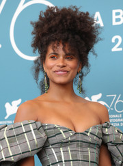 Zazie Beetz wore her voluminous curls pinned on top of her head at the Venice Film Festival photocall for 'Joker.'