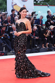 Nicole Warne cut an ultra-glam figure in a strapless, beaded black gown at the Venice Film Festival screening of 'Joker.'