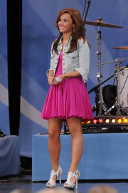 Demi hit the stage sporting platform Zoo Bar sandals with rhinestone embellishments.