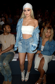 Kylie Jenner finished off her sexy top with an embellished denim jacket by Jonathan Simkhai.