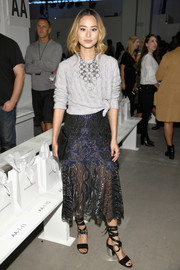Jamie Chung pulled her look together with a pair of chunky-heeled leg-wrap sandals.