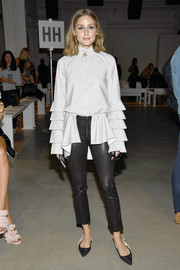 Olivia Palermo got frilled up in a pearl-gray ruffle blouse by Jonathan Simkhai for the brand's fashion show.