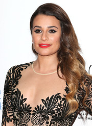 Lea Michele added a jolt for color to her look with bright red lipstick.