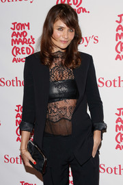 Helena Christensen accessorized with a classic black frame clutch when she attended Jony and Marc's (Red) Auction.