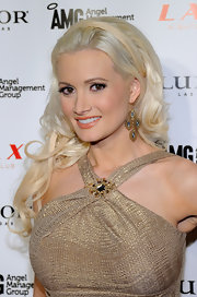 Holly Madison completed her golden look with long blond curls.