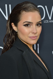 Olivia Culpo attended the Jovani LA flagship opening rocking a wet-look hairstyle.