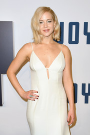 Jennifer Lawrence sported a  red mani for a spot of color to her white gown at the New York premiere of 'Joy.'
