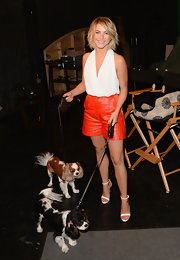 Julianne Hough looked smart and sexy in orange leather shorts and a white halter top at the Purina Pets at Work campaign.
