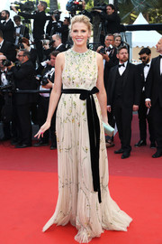 Lara Stone was demure and classic in a sleeveless, beaded nude gown by Prada at the Cannes premiere of 'Julieta.'
