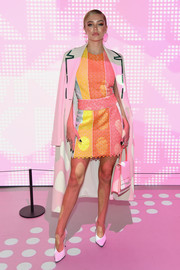 Delilah Belle Hamlin layered a white coat over a multicolored mini dress for the Jump Into Spring: MICHAEL Michael Kors launch party.