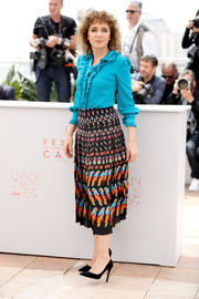 Valeria Golino donned an aqua-blue ruffle blouse for the Cannes jury photocall.