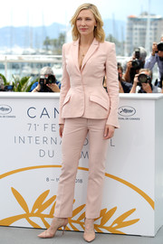 Cate Blanchett teamed her suit with nude pumps by Aquazurra.