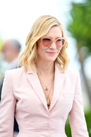Cate Blanchett accessorized with pink Andy Wolf cateye sunnies to match her suit at the 2018 Cannes Film Festival jury photocall.