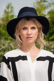 Clemence Poesy attended the 'Jury Revelation Cartier' photocall wearing a navy walker hat.