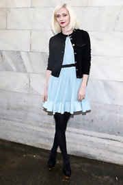 Portia Freeman paired a black cardigan over her baby blue dress for a youthful yet classy feel.