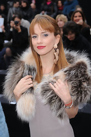 Chiara Lezzi wore gold leaf earrings to the Just Cavalli show.