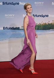 Brooklyn Decker offset her lavender gown with pointy orange patent stilettos with crisscrossing straps.